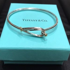 Tiffany and Co. silver and gold bangle.